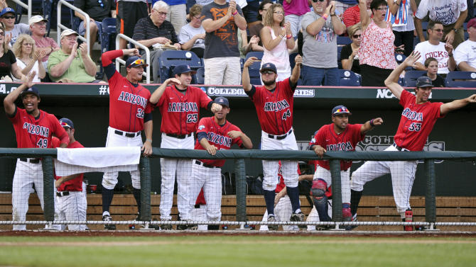 Arizona players, including Mathew Troupe (44), Lucas Long (23) and Augey Bill (33), celebrate after Robert Refsnyder hit a two-run home run against South Carolina in the first inning of Game 1 of the NCAA College World Series baseball finals in Omaha, Neb., Sunday, June 24, 2012. (AP Photo/Ted Kirk)