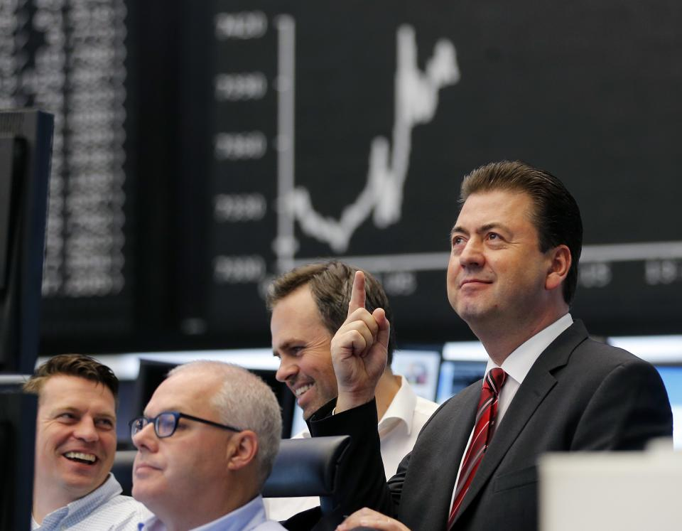 A trader reacts under the curve of the German stock index DAX at the stock market in Frankfurt, Germany, Wednesday, Sept. 12. The top German court rejected calls to block permanent eurozone rescue fund. (AP Photo/Michael Probst)
