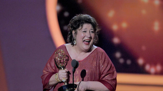 "Margo Martindale accepts the award for outstanding supporting actress in a drama series for ""Justified at the 63rd Primetime Emmy Awards on Sunday, Sept. 18, 2011 in Los Angeles. (AP Photo/Mark J. Terrill)"