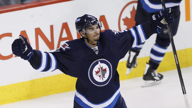 Winnipeg Jets' Evander Kane celebrates after scoring to tie the score against the Boston Bruins during the third period of an NHL hockey game Thursday, April 10, 2014, in Winnipeg, Manitoba. The Jets won 2-1 in a shootout