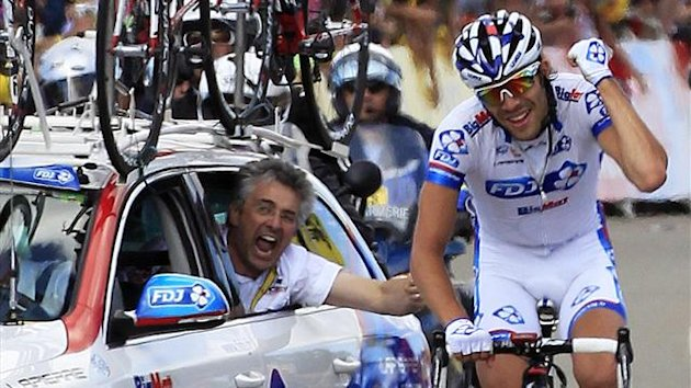 FDJ-Bigmat rider Thibaut Pinot of France is cheered by FDJ sport director Marc Madiot