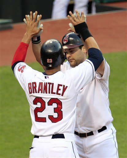 Indians outslug Reds 10-9