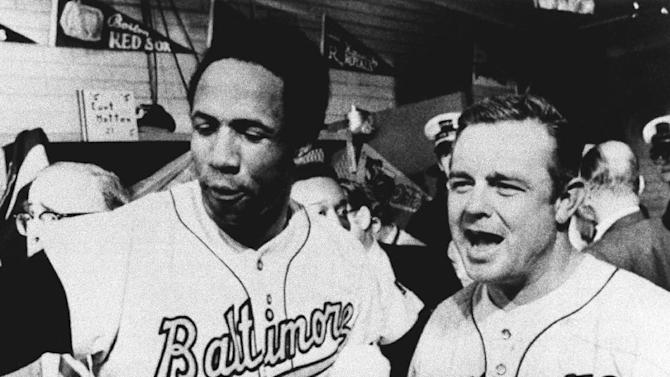 FILE - In this Oct. 6, 1969 file photo, Baltimore Orioles manager Earl Weaver, right, and outfielder Frank Robinson celebrate in the dressing room following their team's 11-2 win over the Minnesota Twins for the American League championship, in Minneapolis.  Weaver, the fiery Hall of Fame manager who won 1,480 games with the Baltimore Orioles, has died, the team announced Saturday, Jan. 19, 2013. He was 82. (AP Photo/File)
