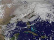 NASA's GOES-13 satellite snapped this photo of two powerful weather systems merging over the East Coast this morning, potentially bringing blizzard-like weather to the region.