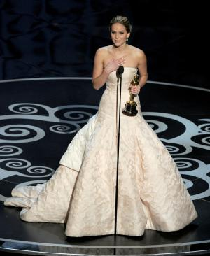"Jennifer Lawrence accepts the award for best actress in a leading role for ""Silver Linings Playbook"" during the Oscars at the Dolby Theatre on Sunday, Feb. 24, 2013, in Los Angeles. (Photo by Chris Pizzello/Invision/AP)"