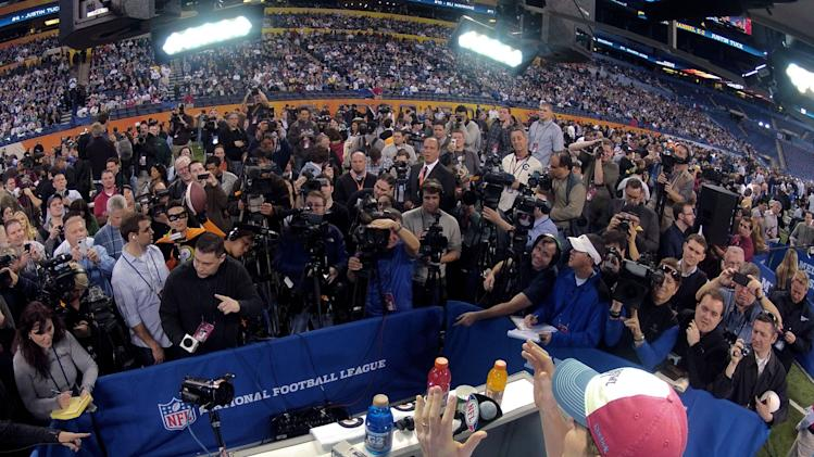 New York Giants quarterback Eli Manning answers questions during Media Day for NFL football's Super Bowl XLVI Tuesday, Jan. 31, 2012, in Indianapolis. (AP Photo/David J. Phillip)