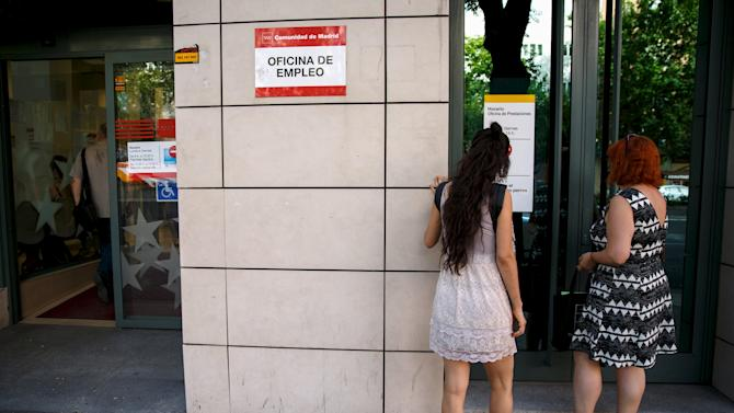 People wait to enter a government-run employment office in Madrid, Spain