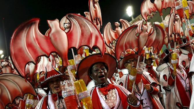 Revellers of the Salgueiro samba school perform during the carnival parade at the Sambadrome in Rio de Janeiro