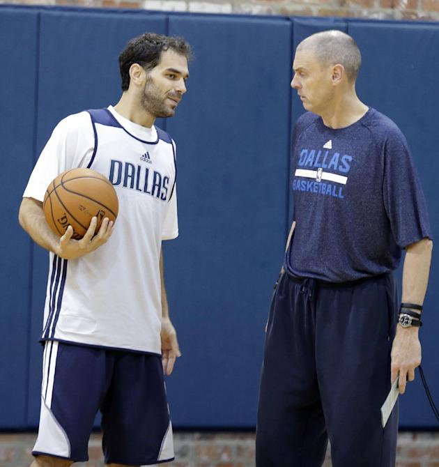 Dallas Mavericks point guard Jose Calderon, left, of Spain, talks with head coach Rick Carlisle during NBA basketball training camp Thursday, Oct. 3, 2013, in Dallas