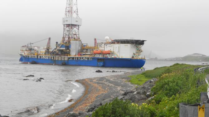 In this Saturday, July 14, 2012 photo provided by Capt. Kristjan B. Laxfoss, a Shell drilling ship drifts near shore near Dutch Harbor on Unalaska Island, Alaska. The Coast Guard says an inspection of the Shell drilling ship that lost its mooring and drifted toward shore of an Alaska Island shows no signs of damage or grounding. (AP Photo/Capt. Kristjan B. Laxfoss)