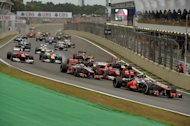 British Formula One driver Lewis Hamilton leads the pack at the Interlagos track, Sao Paulo, Brazil, November 25, 2012. The Dakar 2013 rally gets under way amid growing concern over the potential damage it could cause to the local environment, throwing the spotlight on other sports such as motor racing