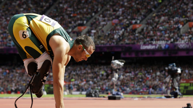 South Africa's Oscar Pistorius starts in a men's 400-meter heat during the athletics in the Olympic Stadium at the 2012 Summer Olympics, London, Saturday, Aug. 4, 2012.(AP Photo/Anja Niedringhaus)