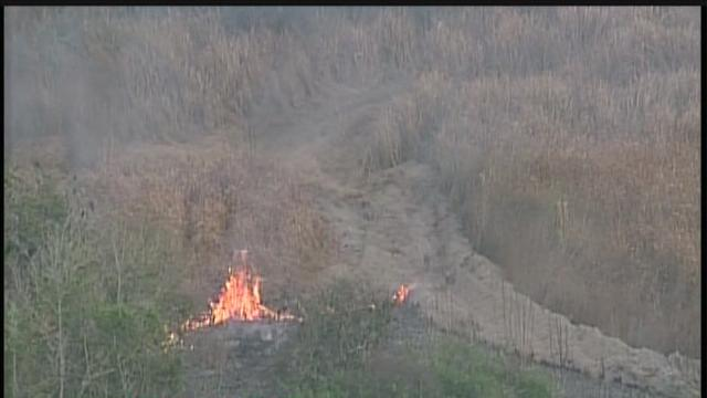 Flames from brush fire near homes in Wamauma