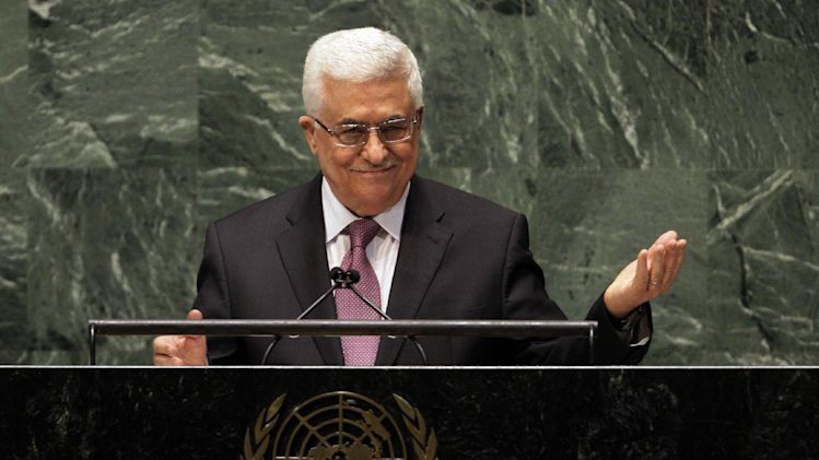 FILE - In this Nov. 29, 2012 file photo, Palestinian President Mahmoud Abbas acknowledges applause before he addresses the United Nations General Assembly. During this week's U.N. General Assembly meetings, Abbas is honoring his promise to the U.S. to suspend, though not to abandon, the Palestinian quest for international recognition. (AP Photo/Richard Drew, File)