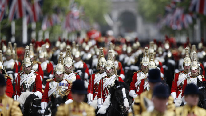 """Household Cavalry ride the Mall after the Trooping The Colour parade,  at the Horse Guards Parade in London, Saturday, June 15, 2013. Queen Elizabeth II celebrated her birthday with traditional pomp and circumstance _ but without her husband by her side.  Prince Philip remains in the hospital, recovering from exploratory abdominal surgery. The queen invited her cousin, the Duke of Kent, to accompany her in a vintage carriage. Other royals — including Prince Harry and the Duchess of Cambridge — joined in the celebration Saturday. More than 1,000 soldiers, horses and musicians are taking part in the parade known as """"Trooping the Color,"""" an annual ceremony.  (AP Photo/Sang Tan)"""