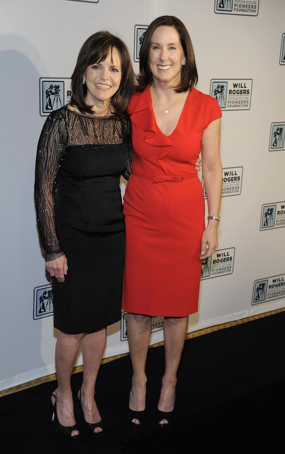 Film producer and honoree Kathleen Kennedy, right, poses with actress Sally Field at the Pioneer of the Year Dinner at CinemaCon 2013 at Caesars Palace on Wednesday, April 17, 2013 in Las Vegas. (Photo by Chris Pizzello/Invision/AP)
