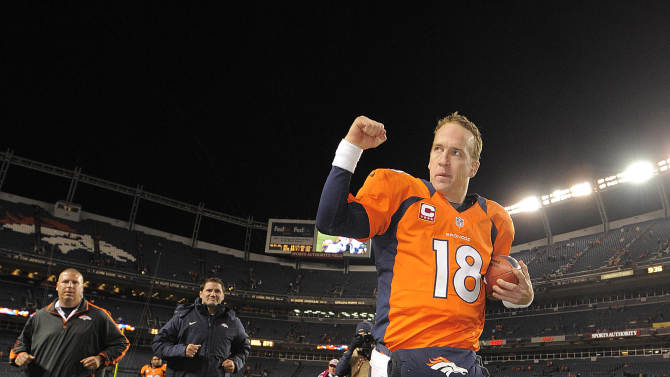 FILE - In this Oct. 28, 2012, file photo, Denver Broncos quarterback Peyton Manning (18) reacts as he runs off the field after the Broncos defeated the New Orleans Saints 34-14 in an NFL football game in Denver. Manning won The Associated Press 2012 NFL Comback Player of the Year award on Saturday, Feb. 2, 2013. (AP Photo/Jack Dempsey, File)