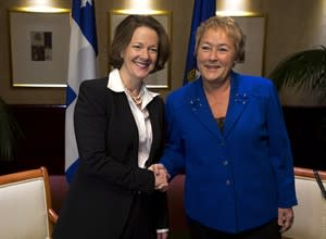 Alberta Premier Alison Redford, left, and Quebec Premier Pauline Marois exchange greetings in Halifax on Thursday, November 22, 2012. THE CANADIAN PRESS/Andrew Vaughan