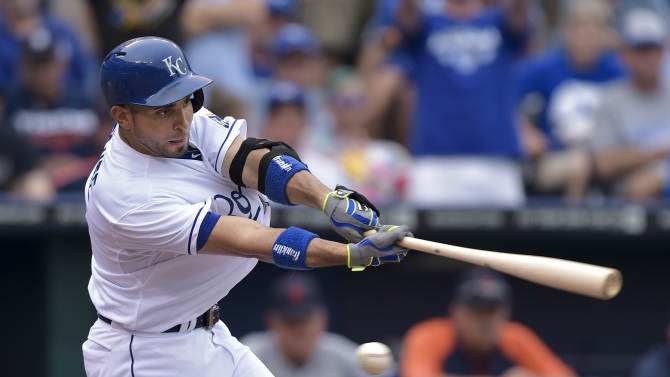 Kansas City Royals second baseman Omar Infante (14) bats against the Detroit Tigers during the sixth inning of a baseball game Saturday, Sept. 20, 2014, in Kansas City, Mo. (AP Photo/Reed Hoffmann)