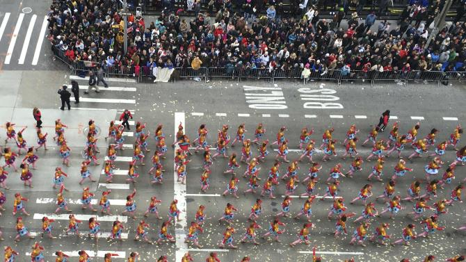 A marching band proceeds along 6th Ave high above 6th Avenue during the 89th Macy's Thanksgiving Day Parade in the Manhattan borough of New York