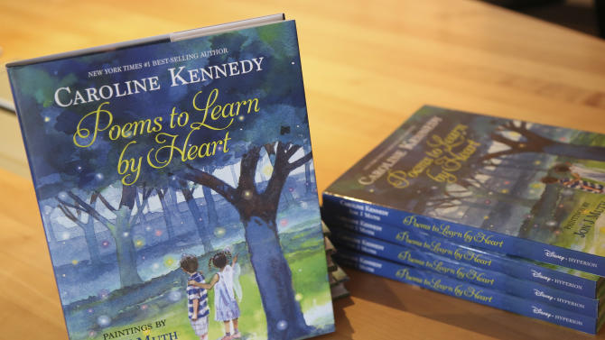 """In this Tuesday, March 26, 2013 photo, copies of Caroline Kennedy's new book """"Poems to Learn by Heart"""" sit on display during an interview with The Associated Press in New York.  (AP Photo/Mary Altaffer)"""