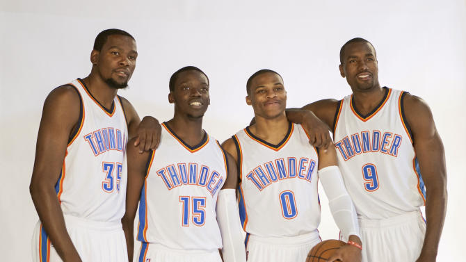 FILE - In this Sept. 29, 2014, file photo, , Oklahoma City Thunder NBA basketball players, from left, Kevin Durant, Reggie Jackson, Russell Westbrook and Serge Ibaka pose for photos during the teams media day in Oklahoma City. The Thunder boast a talented young core but they haven't won a title, and the window could be closing. (AP Photo/Brett Deering, File)