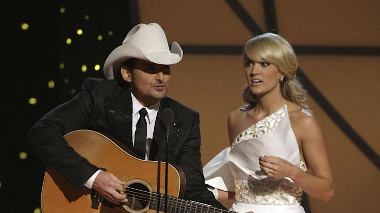 "FILE - In this Nov. 9, 2011 file photo, hosts Brad Paisley, left, and Carrie Underwood speak during the 45th Annual CMA Awards in Nashville, Tenn. The former ""American Idol"" winner's latest album ""Blown Away"" was a multi-week No. 1 on the country albums chart, she's in the midst of an arena tour and she also is up for female vocalist of the year at the CMA Awards, on Thursday, Nov. 1, 2012, airing live on ABC at 8 p.m. EDT from Nashville's Bridgestone Arena.  (AP Photo/Mark Humphrey, File)"