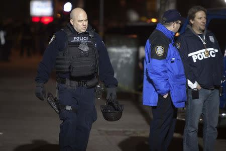 An Emergency Service Unit policeman is pictured at scene of a shooting where two New York Police officers were shot dead in Brooklyn borough of New York