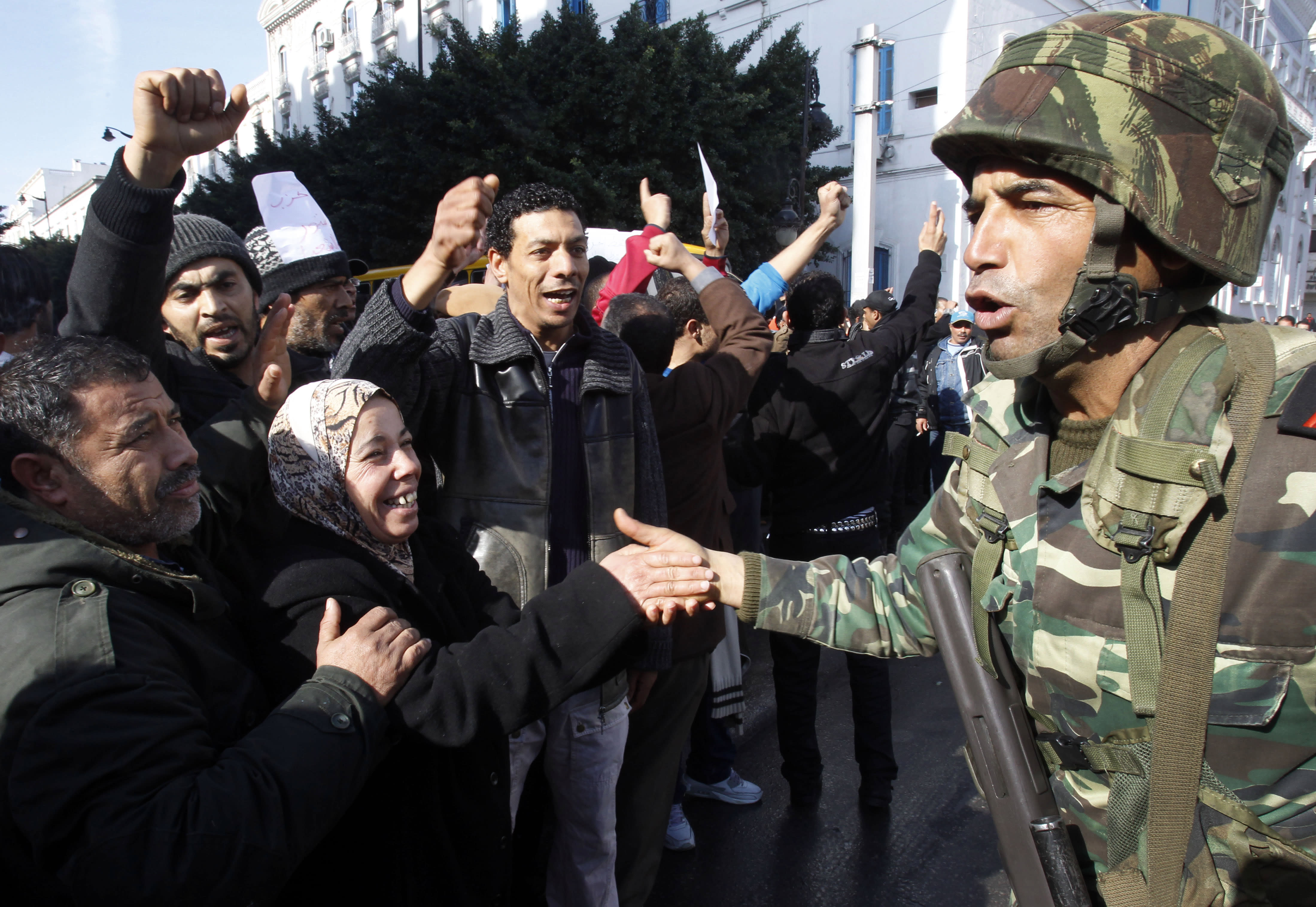 GLANCE: Tunisia, Nobel winner, shines as Arab Spring success