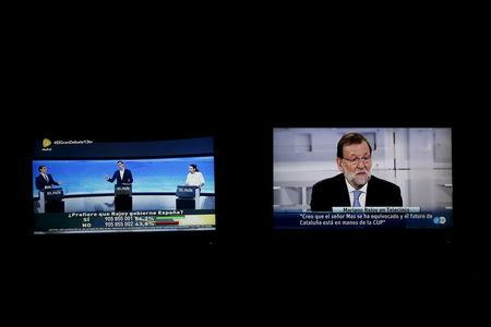 Spain's Rajoy stays away as candidates hold election debate