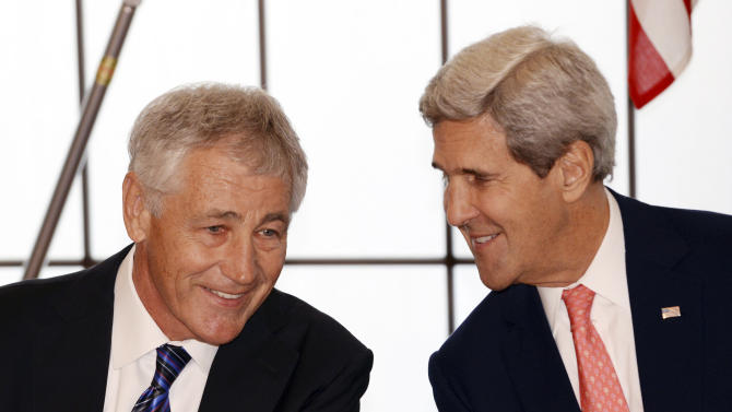 U.S. Secretary of Defense Chuck Hagel, left, listens to U.S. Secretary of State John Kerry prior to the signing ceremony after U.S. and Japan's two-plus-two security talks at Iikura Guesthouse in Tokyo on Thursday, Oct. 3, 2013. U.S. and Japanese officials said Thursday they will position a second early-warning radar in Japan within the next year and deploy new long-range surveillance drones to help monitor disputed islands in the East China Sea by next spring, moves that may well raise tensions again with China. (AP Photo/Toshifumi Kitamura, Pool)