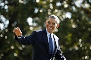 Obama waves as he departs Washington