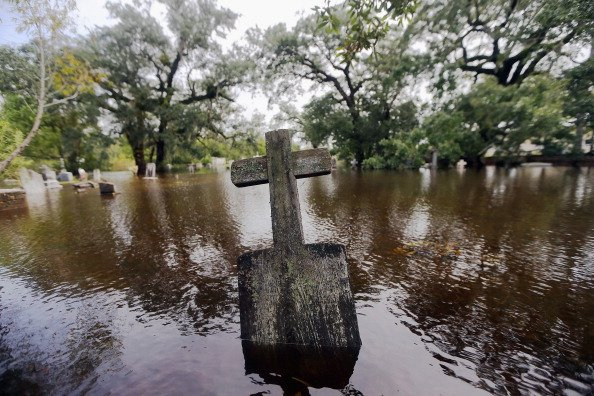 A headstone sits in a flooded cemetery on August 31, 2012 in Slidell, Louisiana. Louisiana residents are coping with the aftermath of Hurricane Isaac with ongoing flooding, destroyed property and many