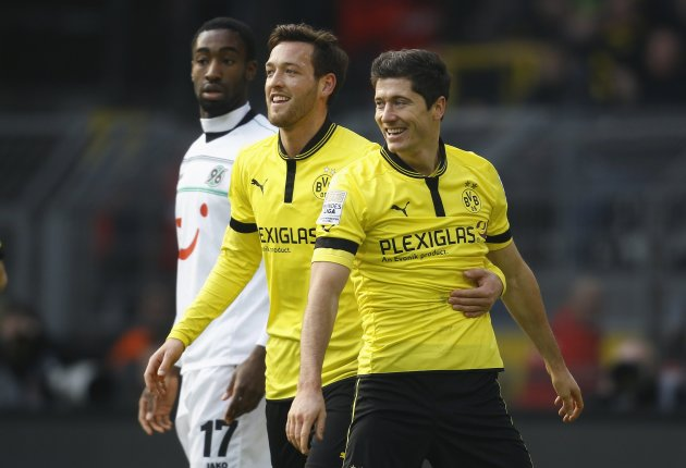 Borussia Dortmund's Schieber and Lewandowski celebrate goal during the German first division Bundesliga soccer match in Dortmund