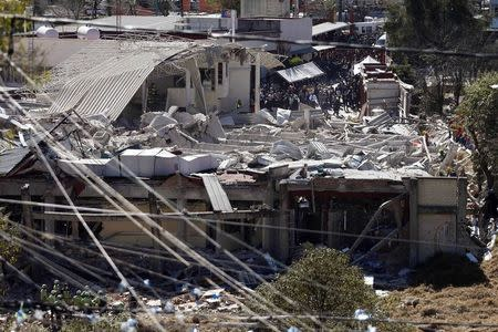 Rescue workers are seen at the site of an explosion at a maternity hospital in Mexico City