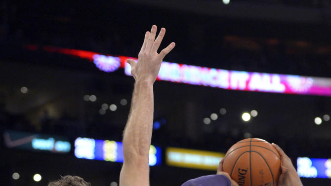 Los Angeles Lakers guard Kobe Bryant puts up a shot as Cleveland Cavaliers forward Luke Walton defends during the first half of an NBA basketball game, Sunday, Jan. 13, 2013, in Los Angeles. (AP Photo/Mark J. Terrill)
