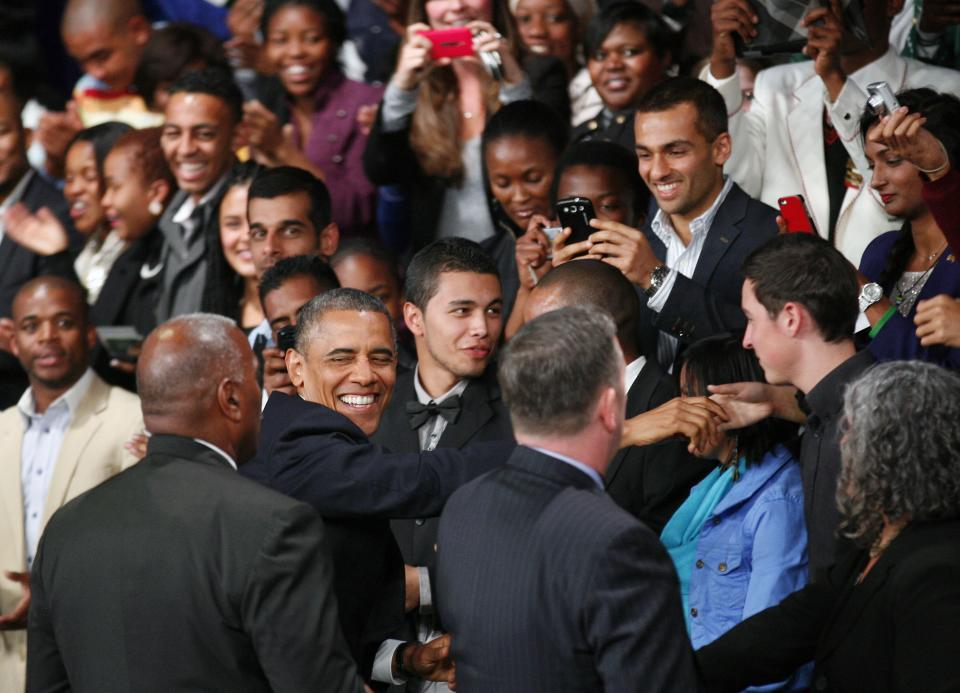 U.S. President Barack Obama greets the public as he arrives to deliver remarks and takes questions at a town hall meeting with young African leaders at the University of Johannesburg Soweto campus Saturday June 29, 2013.(AP Photo/Jerome Delay)