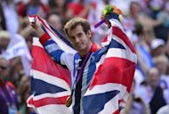 Andy Murray poses with his gold medal after winning the men's singles at the London Olympics on August 5, 2012. Murray, who also won the US Open, believes he will not be a one-Slam wonder like Andy Roddick, who retired from the sport in New York