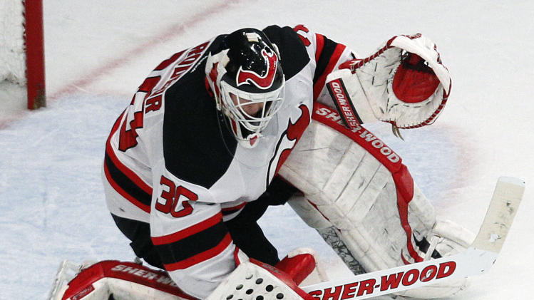 New Jersey Devils goalie Martin Brodeur (30) makes a save during the second period of Game 1 of their NHL hockey Stanley Cup Eastern Conference finals playoff series against the New York Rangers at New York's Madison Square Garden, Monday, May 14, 2012. (AP Photo/Kathy Willens)