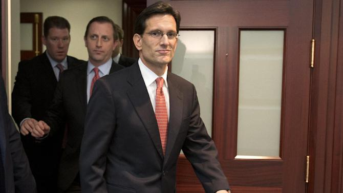 House Majority Leader Eric Cantor of Va. leaves a Republican caucus meeting on Capitol Hill in Washington, Tuesday, Jan. 1, 2013. Squarely in the spotlight, House Republicans began deciding their next move Tuesday after the Senate overwhelmingly approved compromise legislation negating a fiscal cliff of across-the-board tax increases and sweeping spending cuts to the Pentagon and other government agencies. Cantor says he opposed the Senate bill.   (AP Photo/Jacquelyn Martin)