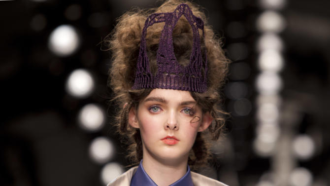 A model wears a design from the Bora Aksu Spring/Summer 2013 collection during London Fashion Week, Friday, Sept. 14, 2012. (AP Photo/Joel Ryan)