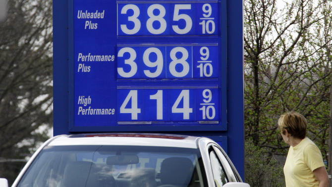 In this March 19, 2012, photo, a motorist pumps gas at a Mount Lebanon, Pa., mini-mart. A statistical analysis of 36 years of monthly inflation-adjusted gasoline prices and U.S. domestic oil production by The Associated Press shows no statistical correlation between how much oil comes out of U.S. wells and the price at the pump. (AP Photo/Gene J. Puskar)