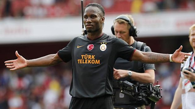 Didier Drogba celebrates scoring against Arsenal (AFP)