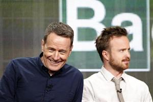 "Cranston smiles next to Paul at a panel for the television series ""Breaking Bad"" during the AMC portion of the Television Critics Association Summer press tour in Beverly Hills"