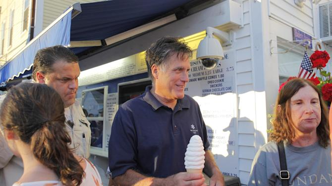 Republican presidential candidate Mitt Romney buys ice cream from Bailey's Bubble in Wolfeboro, N.H., Monday, July 2, 2012, as he continues his vacation from the campaign trail. (AP Photo/Charles Dharapak)