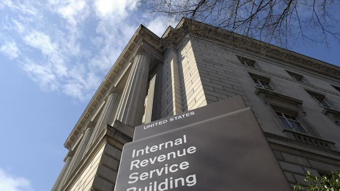 This photo taken March 22, 2013, shows the exterior of the Internal Revenue Service (IRS) building in Washington. The IRS issued $4 billion in fraudulent tax refunds last year to people using stolen identities, with some of the money going to addresses in Bulgaria, Lithuania and Ireland, according to a Treasury report released Thursday. The IRS sent a total of 655 tax refunds to a single address in Lithuania, and 343 refunds went to a lone address in Shanghai. (AP Photo/Susan Walsh)