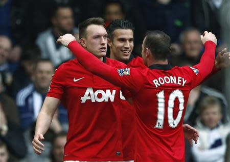 Manchester United's Jones celebrates with team mates after scoring a goal against West Bromwich Albion during their English Premier League soccer match at The Hawthorns in West Bromwich