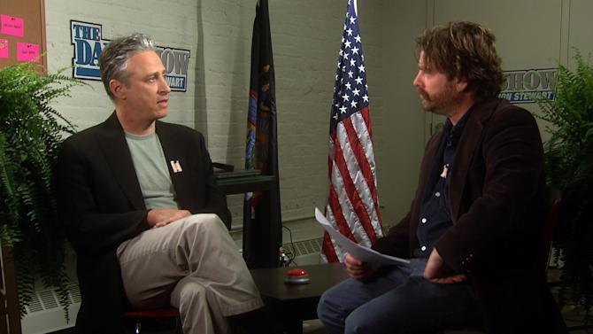 "In this undated image from video released by Comedy Central, host Zach Galifianakis, right, talks with Jon Stewart, comedian and host of ""The Daily Show with Jon Stewart,"" from ""Between Two Ferns: A Fairytale of New York""  a 30-minute special premiering on Sunday, May 6 at 8:30 p.m. EST on Comedy Central. (AP Photo/Comedy Central)"
