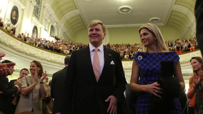 King Willem-Alexander of the Netherlands and Queen Maxima enter the hall as they attend a concert by Royal Concertgebouw Orchestra at the Tchaikovsky Conservatory in Moscow, Saturday, Nov. 9, 2013. The royal visit was expected to showcase friendly ties between Russia and the Netherlands, but it comes amid increasing tensions over the seizure of the Dutch-flagged Greenpeace ship and its crew and other disputes. (AP Photo/Maxim Shipenkov, Pool)