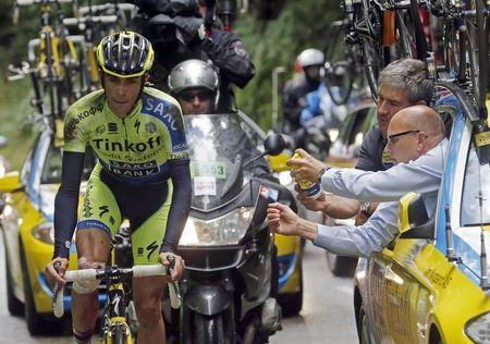 Tinkoff-Saxo team rider Contador of Spain gets mechanic assistance after he fell during the 161.5-km tenth stage of the Tour de France cycling race